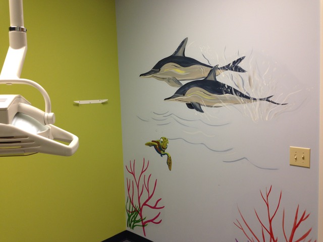 Dolphins on the wall of an office